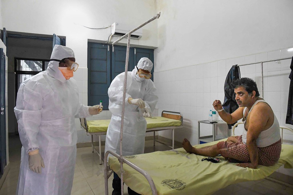 Patna: Medics take samples from a patient in the isolation ward of novel coronavirus (COVID-19) at Patna Medical College and Hospital (PMCH) in Patna, Saturday, March 14, 2020. (PTI Photo)(PTI14-03-2020_000040B)