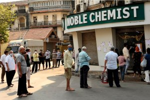 Mumbai: People maintain social distance as they wait outside a chemist shop during a 21-day nationwide lockdown in the wake of coronavirus pandemic, at Girgaon in Mumbai, Wednesday, March 25, 2020. (PTI Photo/Kunal Patil)(PTI25-03-2020 000142B)