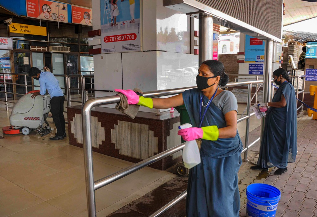Patna: Volunteers sanitize a railing as a measure to prevent the spread of coronavirus, during nation-wide lockdown, at Jaiprakash Naryan Airport in Patna, Wednesday, March 25, 2020. (PTI Photo)(PTI25-03-2020 000212B)