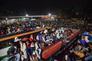Thousands of migrant workers from Delhi, Haryana and even Punjab reached Anand Vihar Bus Terminus in national capital during CoronaVirus Lockdown on March 28, 2020. (Photo: PTI)