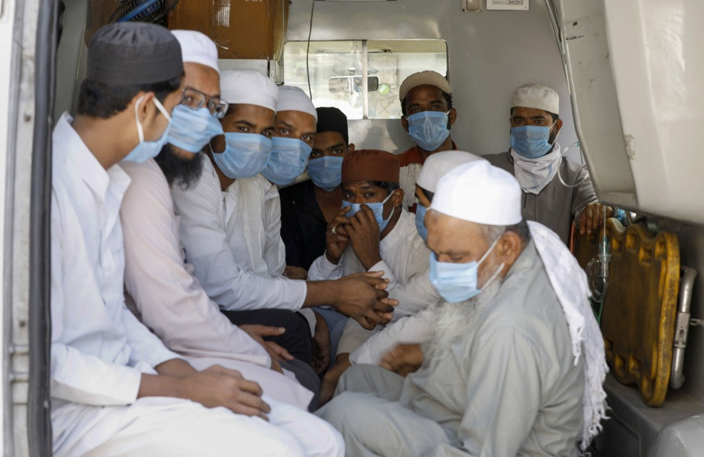 Ahmedabad: Members of Muslim community who had visited several Muslim missionary gatherings including 'Jamat' at Nizamuddin Mosque in New Delhi, wear masks as they are being taken to a quarantine facility during a nationwide lockdown in the wake of coronavirus pandemic, in Ahmedabad, Friday, April 3, 2020. (PTI Photo)(PTI03-04-2020_000190B)