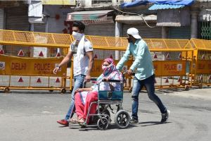New Delhi: A patient on a wheelchair is escorted by family members to a hospital amid a nationwide lockdown in the wake of coronavirus pandemic, in New Delhi, Friday, April 3, 2020. (PTI Photo/Shahbaz Khan)(PTI03-04-2020_000073B)