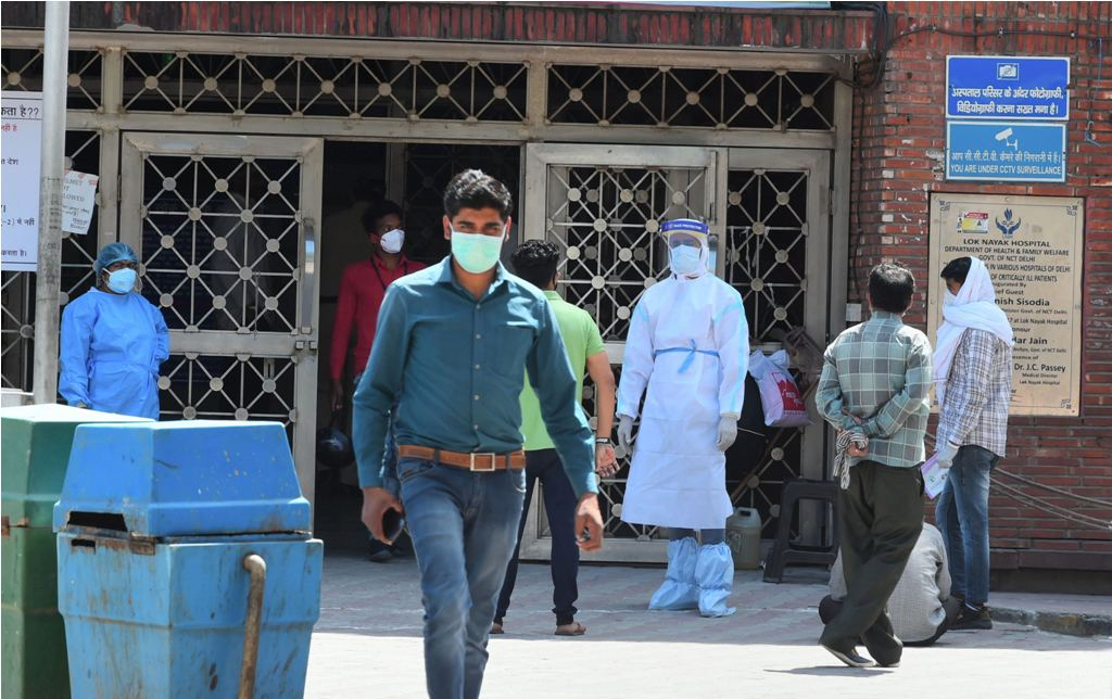 New Delhi: A medic wearing a protective suit as a preventive measure against coronavirus, stands outside the building gate of Lok Nayak Jai Prakash Narayan (LNJP) hospital, in New Delhi, Friday, April 3, 2020. LNJP is among few hospitals in Delhi where COVID 19 patients are attended round the clock. (PTI Photo/ Shahbaz Khan)(PTI03-04-2020_000114B)