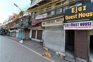 New Delhi: Stray dogs sleep outside closed shops amid a nationwide lockdown in the wake of coronavirus pandemic, near Jama Masjid in New Delhi, Friday, April 3, 2020. (PTI Photo/Shahbaz Khan)(PTI03-04-2020 000117B)