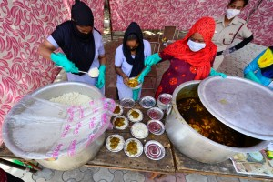 New Delhi: Volunteers distribute food among the needy during a nationwide lockdown in the wake of coronavirus outbreak, at a relief camp in New Delhi, Friday, April 3, 2020. (PTI Photo/Kamal Kishore)(PTI03-04-2020_000137B)
