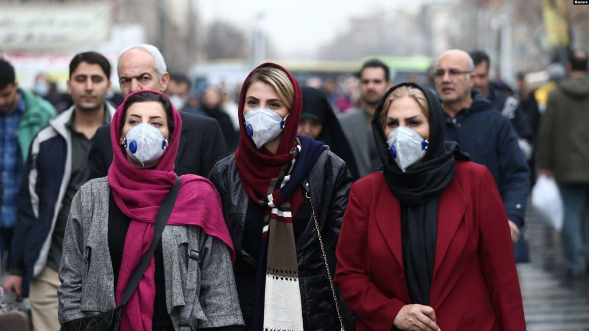 Iranian women wear masks to prevent contracting the coronavirus at the Grand Bazaar in Tehran as infections spread throughout the Middle East [File: Nazanin Tabatabaee/WANA via Reuters]