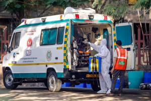 A civic worker disinfecting an ambulance in Mumbai on April 15 (Photo: PTI)