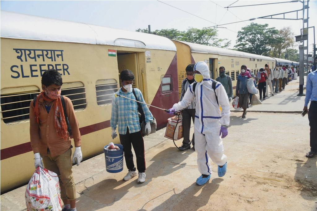 Patna: A health worker sanitizes migrants who have arrived from Jaipur by Shramik Special train at Danapur junction, during the nationwide lockdown to curb the spread of coronavirus, in Patna, Saturday, May 02, 2020. (PTI Photo)(PTI02-05-2020 000079B)