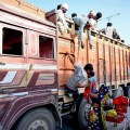 **EDS: RPT WITH CAPTION CORRECTION** Rewa: Rewa: Migrants board a truck at Chakghat border to return to their native places in Uttar Pradesh during the ongoing nationwide COVID-19 lockdown, in Rewa district of Madhya Pradesh, Monday, May 11, 2020. (PTI Photo)(PTI11-05-2020 000233B) *** Local Caption ***