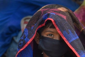 Sonipat: A migrant waits for a means of transport to travel to his native place during the fourth phase of the ongoing COVID-19 nationwide lockdown, at Kundali Industrial Area in Sonipat, Monday, May 18, 2020. (PTI Photo/Atul Yadav)(PTI18-05-2020_000211B)