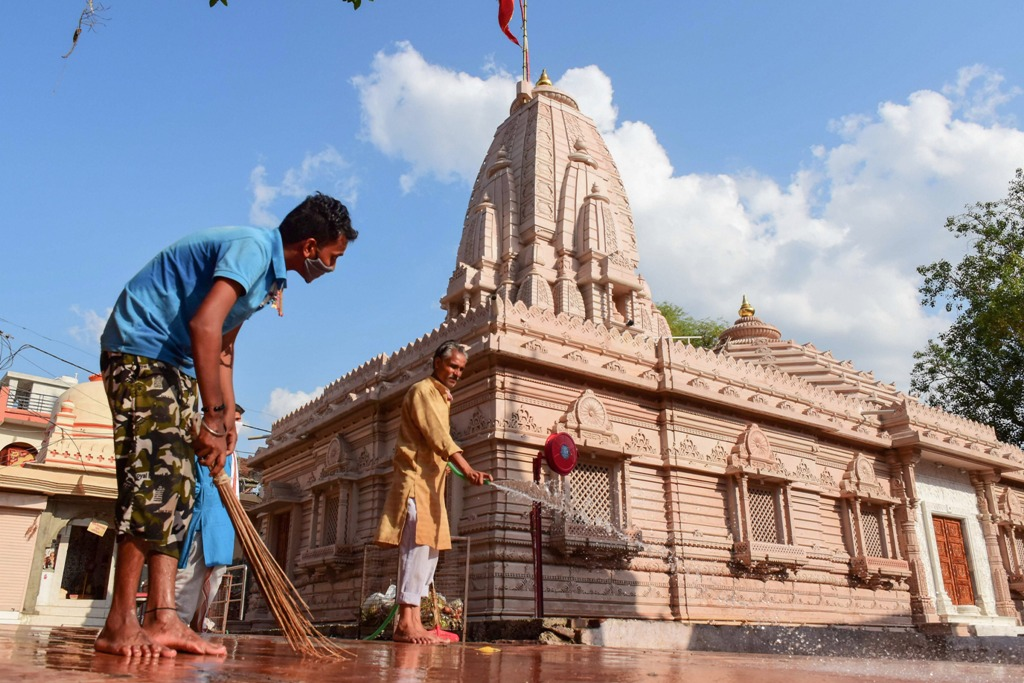 Jabalpur: A worker cleans the premises of Goddess Khermai temple, ahead of its re-opening, during the ongoing COVID-19 lockdown, in Jabalpur, Saturday, June 6, 2020. (PTI Photo)(PTI06-06-2020 000164B)