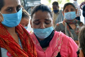 Amritsar: A relative reacts as she waits for the arrival of her family member, who was deported from Malaysia and subsequently stranded due to coronavirus pandemic, at Guru Ram Das Ji International Airport in Amritsar,Saturday, July 11, 2020. (PTI Photo)(PTI11-07-2020 000195B)