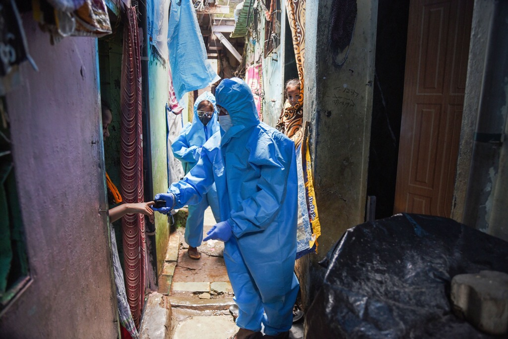 Mumbai: Health workers wearing PPE suits arrive to conduct screening of the residents in a COVID-19 containment zone at Malad in Mumbai, Sunday, July 12, 2020. (PTI Photo)
