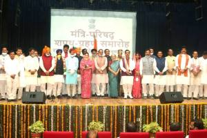 Bhopal: Madhya Pradesh Governor Anandiben Patel and Chief Minister Shivraj Chouhan pose for a group photo with the newly inducted ministers of the State Cabinet, after the swearing-in ceremony at Raj Bhawan in Bhopal, Thursday, July 2, 2020. (PTI Photo) (PTI02-07-2020 000089B)