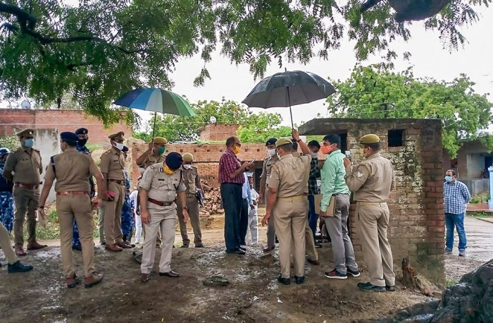 Kanpur: A special investigation team visits the Bikaru Village, where eight policemen were killed by gangster Vikas Dubey on July 3, for investigation into the case in Kanpur, Sunday, July 12, 2020. Dubey was also killed in an encounter on July 10. (PTI Photo)