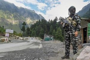 A security personnel stands guard along the Srinagar-Ladakh Highway, at Gagangir in Ganderbal District of Central Kashmir. — PTI photo