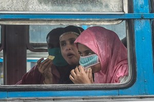 Kolkata: A passenger lifts her face mask to eat food in a bus, during Unlock 4.0, in Kolkata, Wednesday, Sep 2, 2020. (PTI Photo/Ashok Bhaumik)(PTI02-09-2020_000108B)