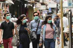 New Delhi: Pedestrians wear protective masks, in wake of the deadly novel coronavirus, at Khan Market in New Delhi, Friday, March 6, 2020. (PTI Photo/Arun Sharma)(PTI06-03-2020_000137B)