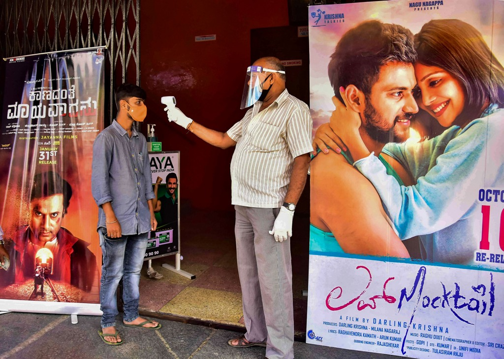 Bengaluru: A young man undergoes thermal screening at a cinema hall after it reopened for visitors, Unlock 5, in Bengaluru, Thursday, Oct. 15, 2020. (PTI Photo)(PTI15-10-2020 000143B)