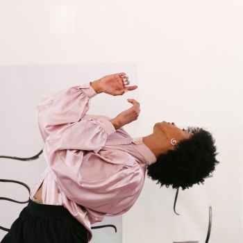 sensual slim queer man dancing in modern studio