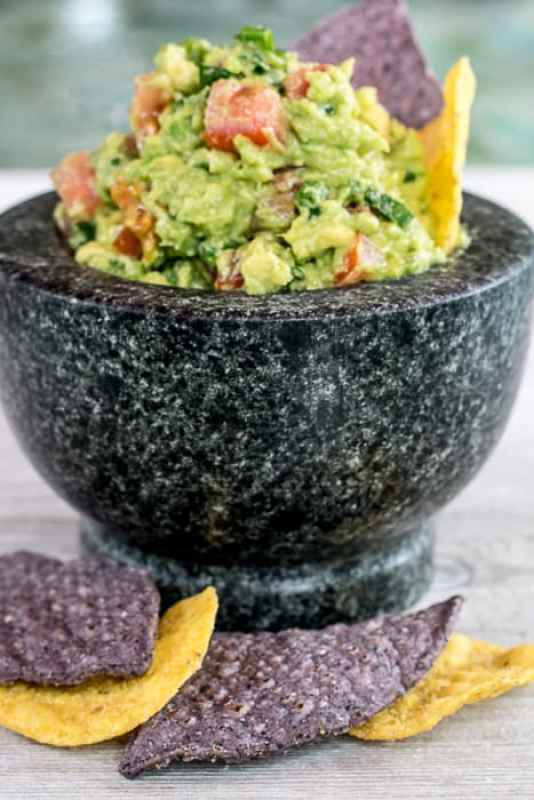image of guacamole in bowl surrounded by chips