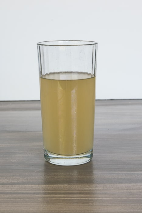 picture of a glass of brown water