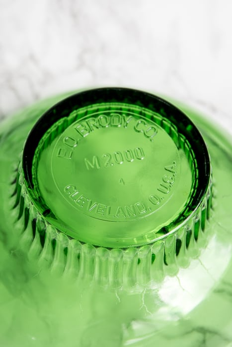 picture showing bottom of a green pressed glass bowl stating Cleveland, Ohio U.S.A.