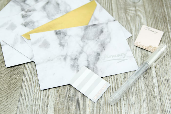 picture of marble pattern envelopes, pen and note stickers