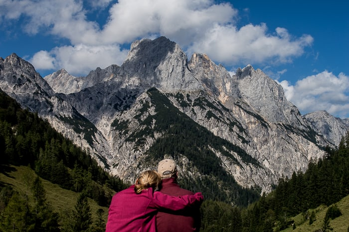 picture of two people looking at a mountain