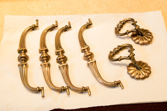 Picture of brass hardware drying on paper towel