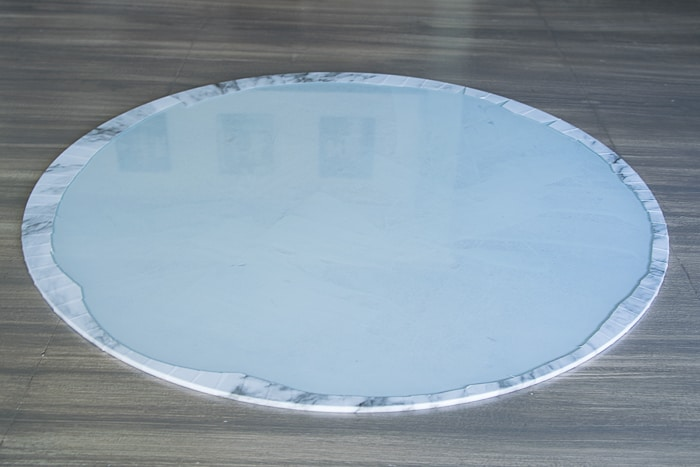 picture showing underside of glass round with marble shelf liner adhered
