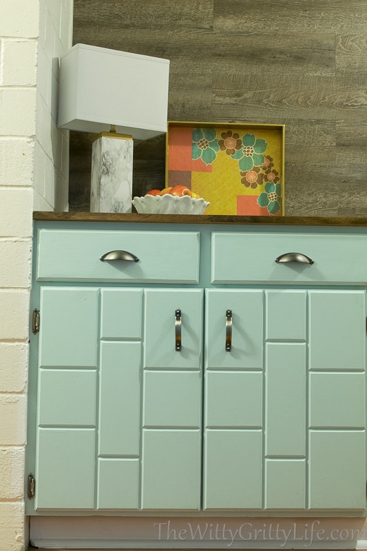 What a change in appearance after receiving some well deserved TLC. The cabinet painted and restored.