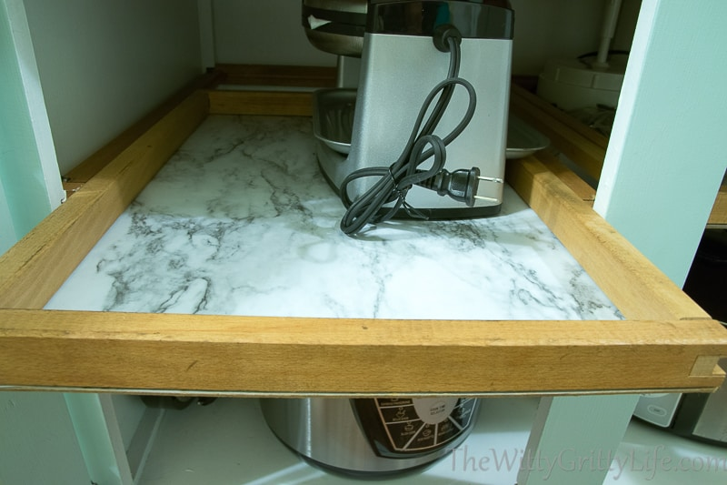 even the pullout drawers have marble liners