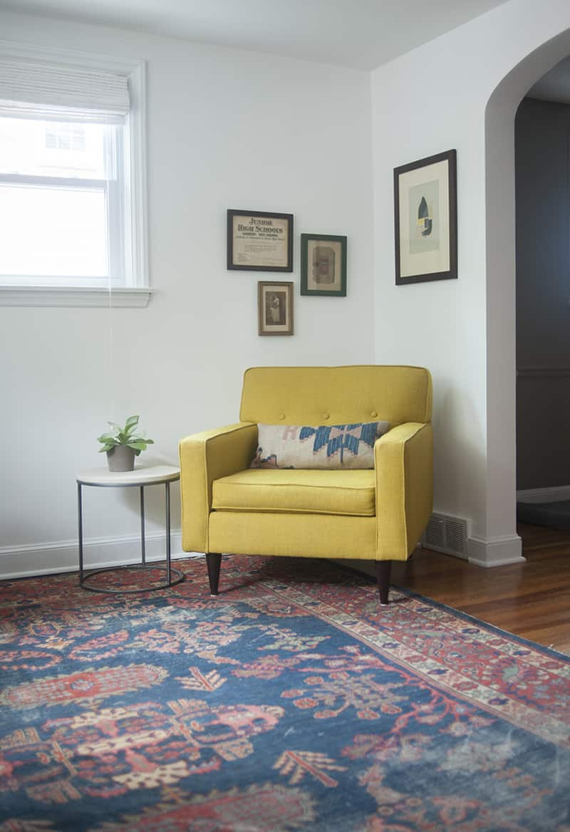 corner with yellow upholstered chair