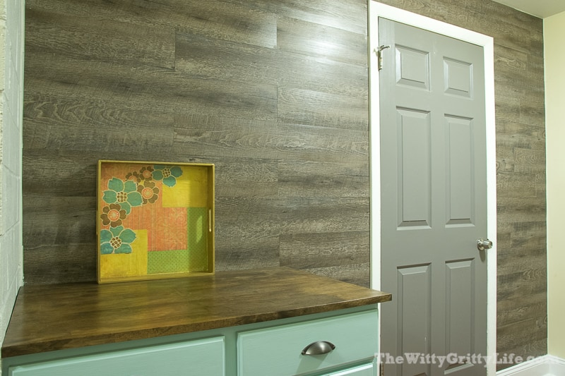 after picture of completed vinyl plank wall