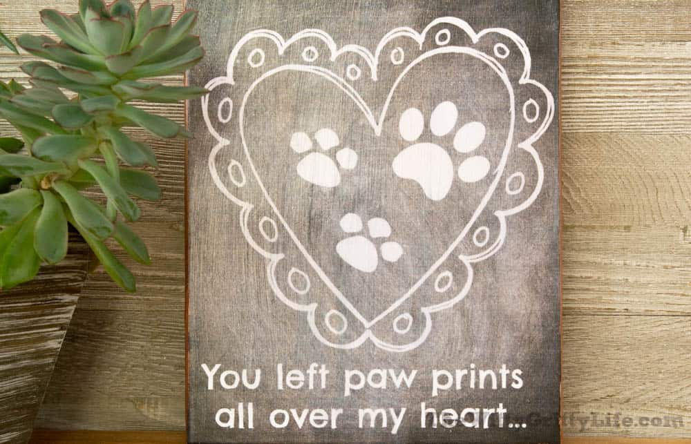 """Diy wall sign with quote """"you left paw prints all over my heart."""""""