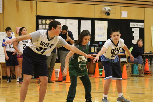 Wolf defense hard at work at their second game on 2/1