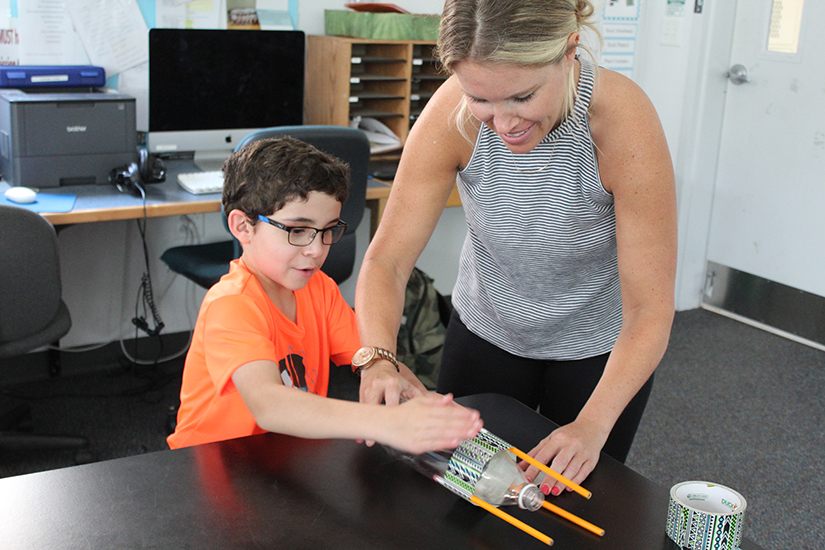Staff and students work together to make bottle rockets
