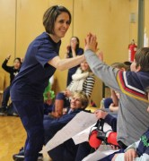 Head of School, Anna Johnson, takes a break from playing to give some high fives!