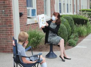 Wolf School teacher holds class outside