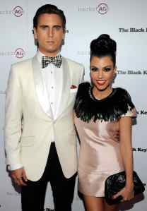 """Television personalities Scott Disick (L) and Kourtney Kardashian arrive at the launch of AG Adriano Goldschmied's """"backstAGe presents:"""" initiative featuring The Black Keys at the Marquee Nightclub at the Cosmopolitan of Las Vegas February 14, 2011 in Las Vegas, Nevada."""