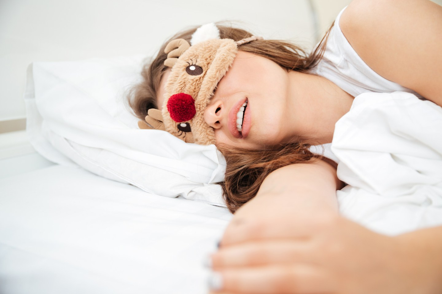 Beautiful woman sleeping on the bed with eye mask