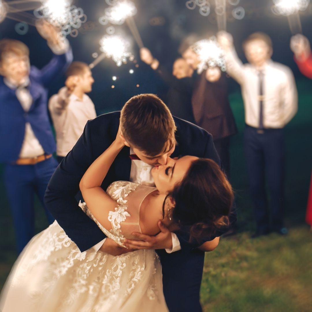 groom kissing bride during an evening wedding ceremony