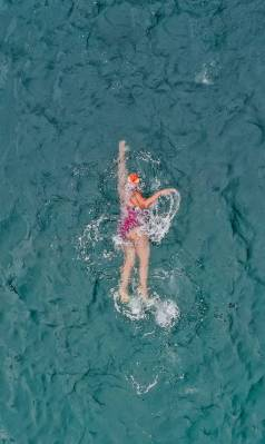 woman swimming professionally in sea water