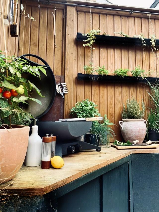 Outdoor kitchen with corten steel splash back.