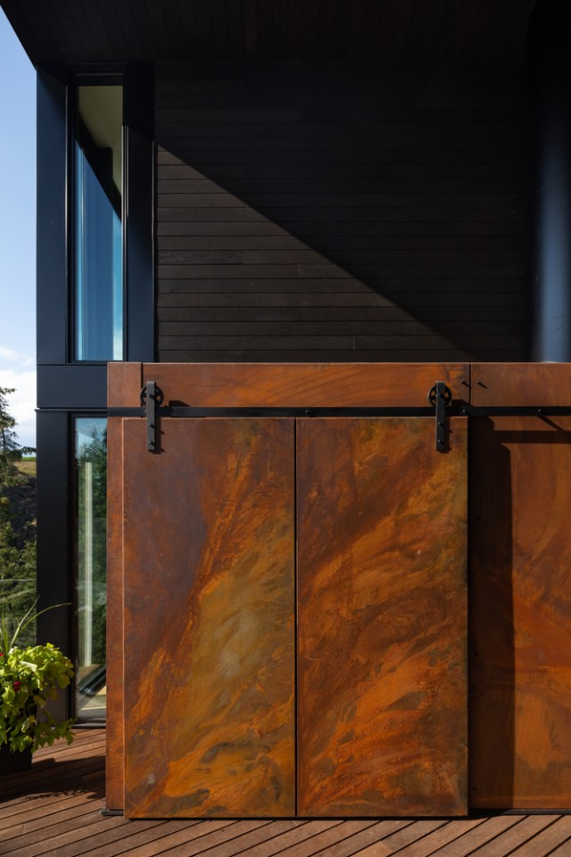 Sliding doors made from corten steel.
