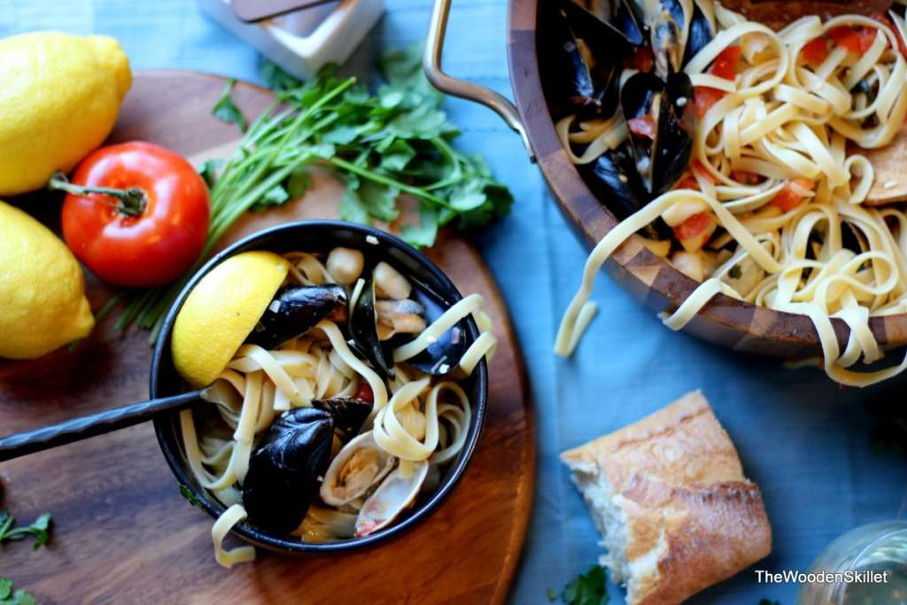 Fettuccine with Mussels, Clams and Bay Scallops in White Wine Sauce - the perfect recipe for seafood pasta and white wine sauce! thewoodenskillet.com #foodphotography #foodstyling