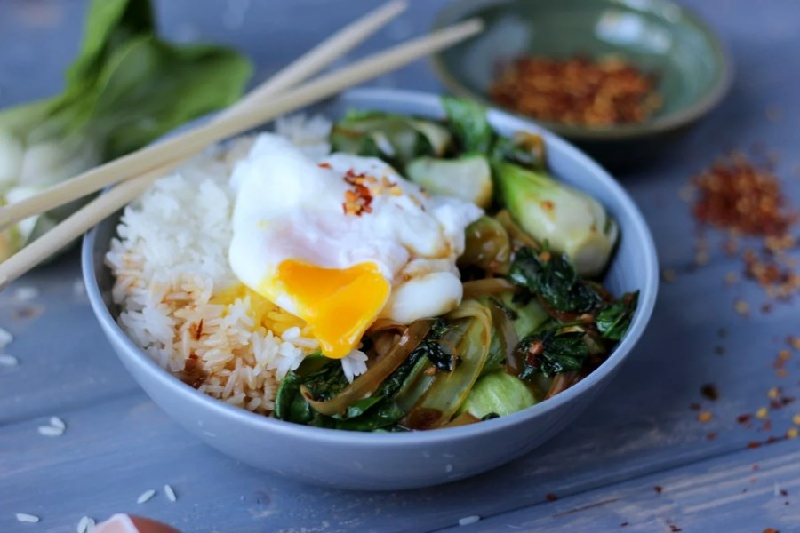 Vegetarian Rice Bowl with Braised Baby Bok Choy, Leeks and Spinach with Poached Egg and Red Pepper Flakes