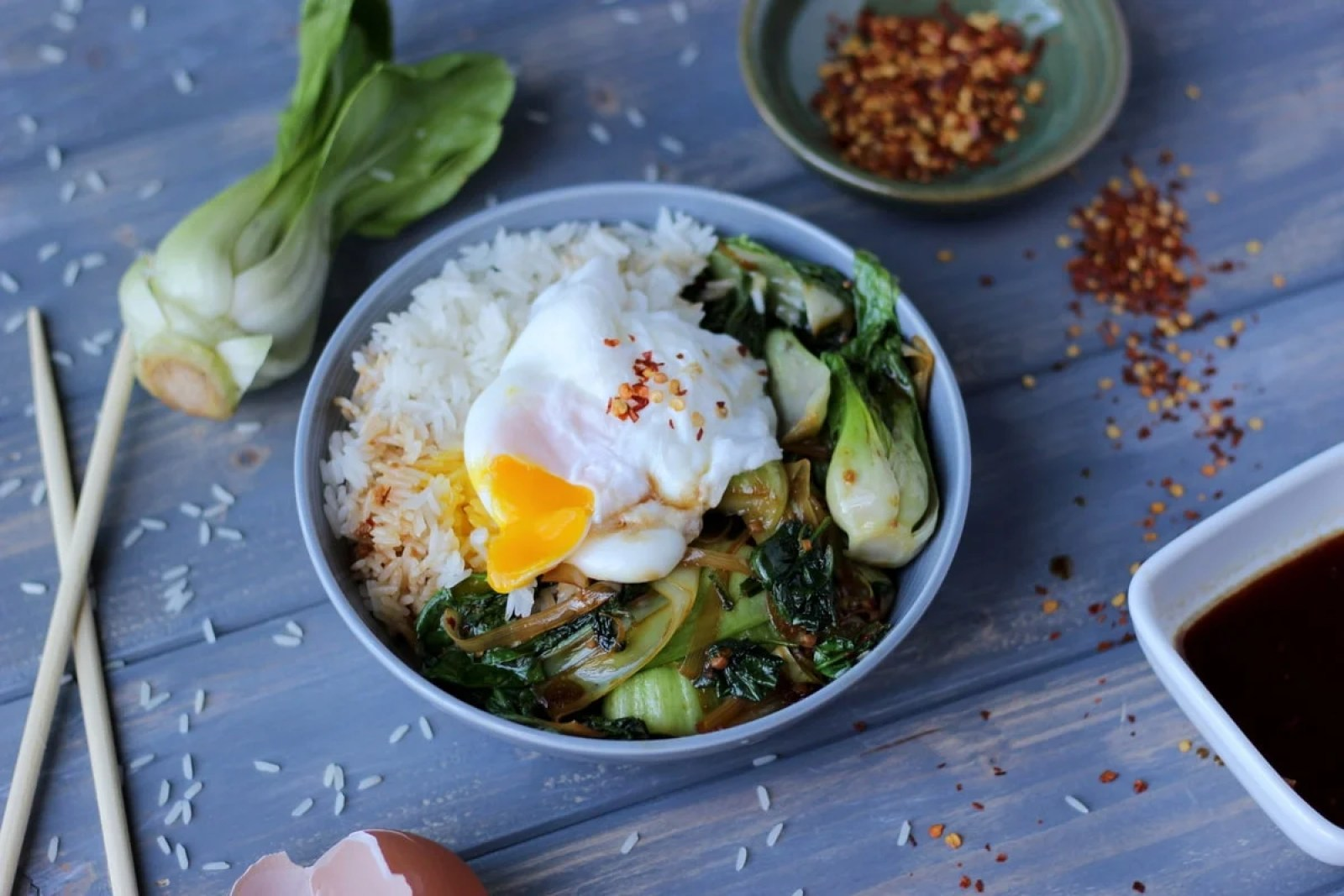 Vegetarian Rice Bowl with Braised Baby Bok Choy, Leeks and Spinach with Poached Egg and Red Pepper Flakes - thewoodenskillet.com