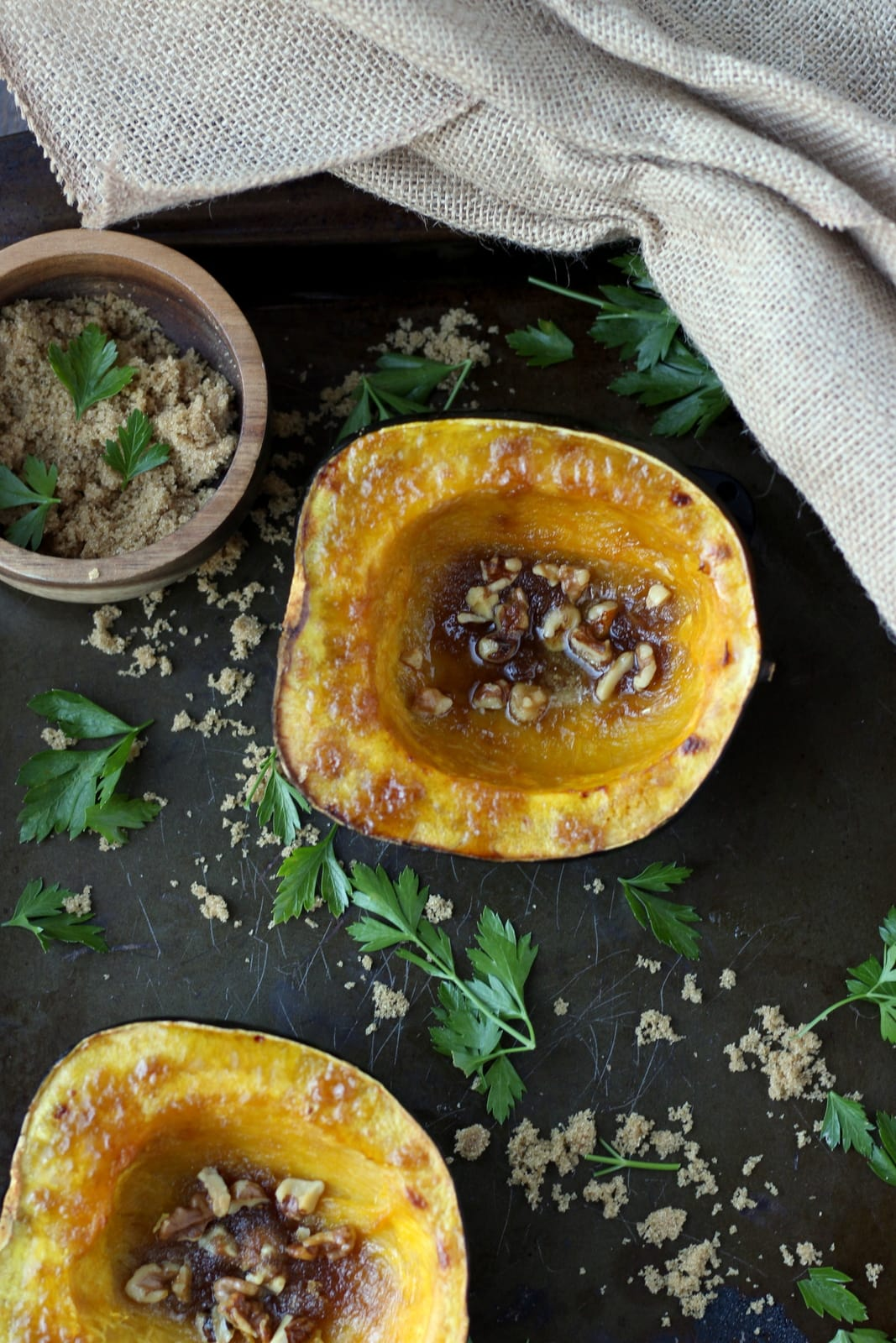 Roasted acorn squash with walnuts, browned butter and brown sugar. How to cook acorn squash. Awesome recipe for fall! thewoodenskillet.com